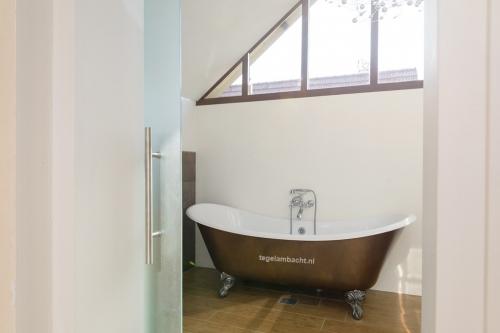 Nieuwe badkamer of toilet? Tegel Ambacht kent de kneepjes van het vak.